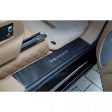 Entrance panels with illuminated Mansory logo (BBE395351) on Bentley Bentayga